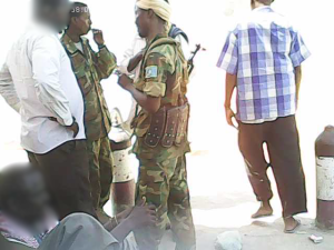 Army officer discussing ammunition sells with known arm trader