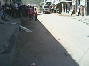 The arms traders sit on the side of the road waiting for customers